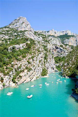 Boats on Gorges du Verdon, Saint Croix lake european canyon and river. Real Tilt Shift Photography. Provence Alps Cote Azur, France.