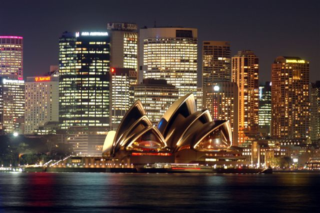 View of the Sydney Opera House with the city behind at dusk