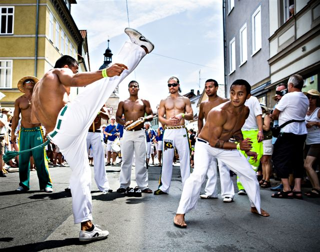 COBURG, GERMANY - JULY 11: The unidentified male capoeira dancers participates at the annual samba festival in Coburg, Germany on July 11, 2010.