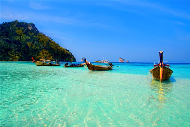 Longtailboats tied up in the turquoise waters at Krabi